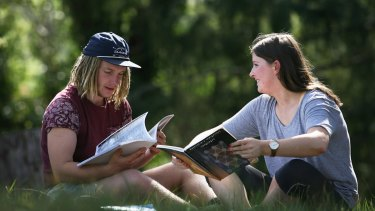 Studying outside: Students learning Dhudhuroa are among a handful who speak the language.