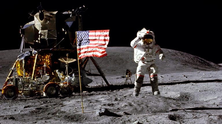 John Young salutes the US flag at the Descartes landing site on the moon during the first Apollo 16 extravehicular activity in 1972.