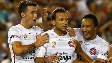 Wanderer Brendon Santalab celebrates after scoring a goal against Melbourne Victory.