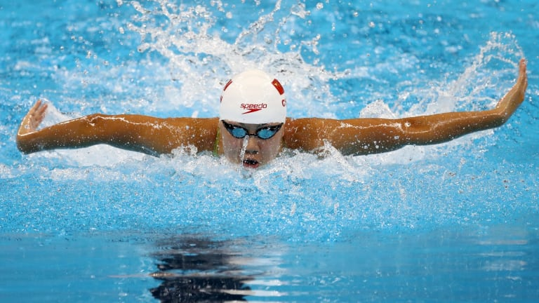 Xinyi Chen of China competes in heat four of the Women's 100m Butterfly.