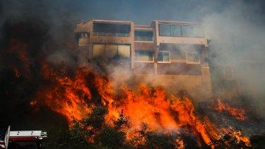 A wildfire threatens a home in Ventura, California.