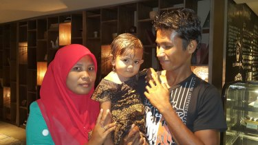 Ali Jasmin, who was jailed by Australia as a child, with his wife Baualan and his 18-month-old daughter Aisah Nuruna.