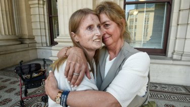 Nia Sims, who suffers from the terminal illness scleroderma, and her friend Jane Morris celebrate the decision in Victoria's lower house to pass the dying with dignity bill.