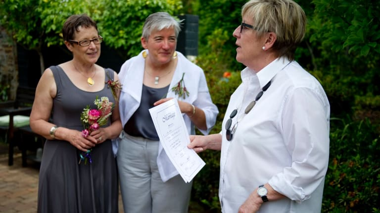 Anne-Marie Delahunt, centre, with her partner Margaret Penrose Clark and marriage celebrant Judy Aulich at their wedding in Canberra on December 9, 2013. The High Court later invalidated their marriage.