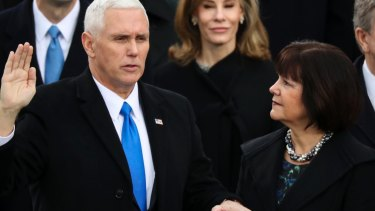 Vice-President Mike Pence is sworn in as his wife Karen holds the Bible during the 58th Presidential Inauguration at the US Capitol in Washington.