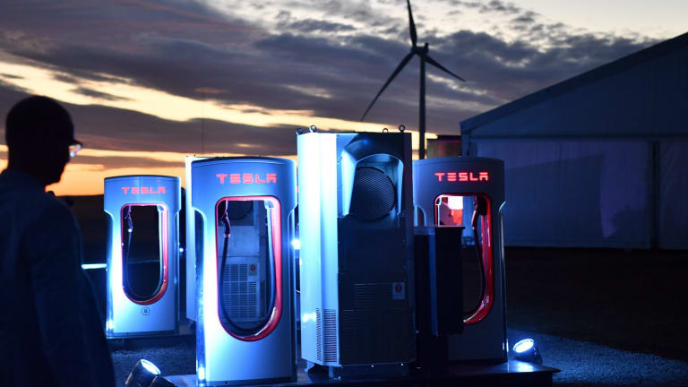 A Tesla car charging station is at the wind and solar battery plant outside of Jamestown, South Australia.