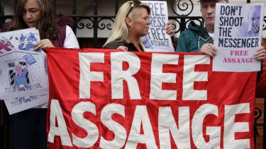 Supporters of WikiLeaks founder Julian Assange stand outside the Ecuadorian embassy.