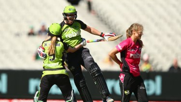 Happy days: Thunder batters Claire Koski and Lauren Cheatle  celebrate after winning the Women's Big Bash League final at the MCG.