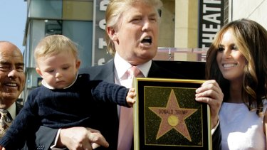 Donald Trump with his wife, Melania, and their son, Barron, pose for a photo after he was given a star on the Hollywood Walk of Fame in Los Angeles in 2007.