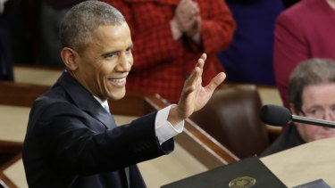 Barack Obama waves before giving his State of the Union address last year. This year's will be his last.
