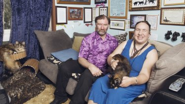 Mark and Maria Slater with their cats in their Leura home.