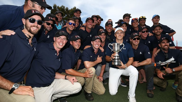 Spotlight: Jordan Spieth poses with greenkeeping staff and the Stonehaven trophy after winning the 2016 Australian Open at Royal Sydney Golf Club.