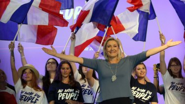 Marine Le Pen waves to supporters during a National Front meeting in September.