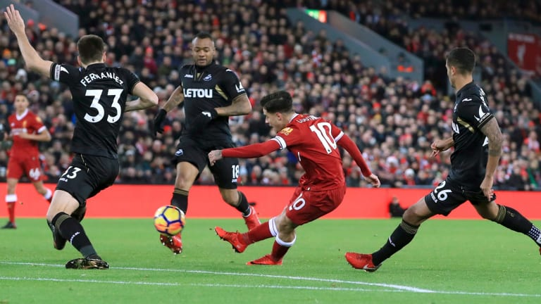 Final flourish: Philippe Coutinho scores against Swansea City on Boxing Day.