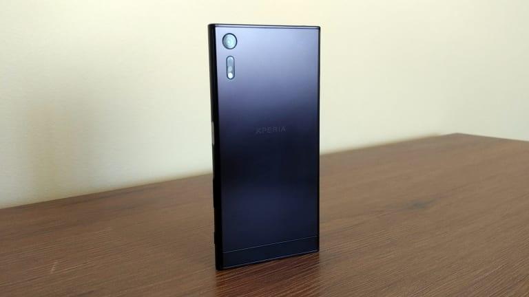 The rear of the phone has a strange, fingerprint-hungry finish.