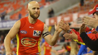 Gary Ablett celebrates the Suns' victory over North Melbourne.