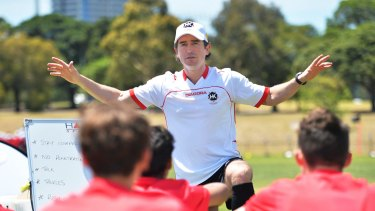 Park life: Harry Kewell guides youngsters in a session at  Albert Park.