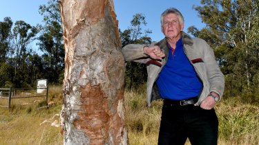 Wayne Olling at the Shanes Park Woodland, a site set aside by the State Government for protection and part of which is now under threat of a new highway.