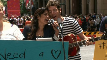 Singer songwriter duo Edo & Jo perform I'll Ride With You in Martin Place.