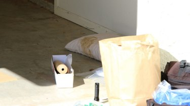 The scene at the Bulimba residence as police investigated.