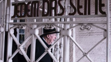 Holocaust survivor Guenter Pappenheim walks through the gates at the old Buchenwald concentration camp near Weimar, Germany to attend a wreath-laying ceremony to mark International Holocaust Remembrance Day on Saturday.