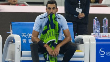Nick Kyrgios rests during a break in the men's singles final match against Rafael Nadal.