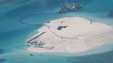 A photo taken Febuary 25, 2014 by surveillance planes a Chinese vessel is used to expand structures and land on the Johnson Reef, called Mabini by the Philippines and Chigua by China, at the Spratly Islands at South China Sea, Philippines.