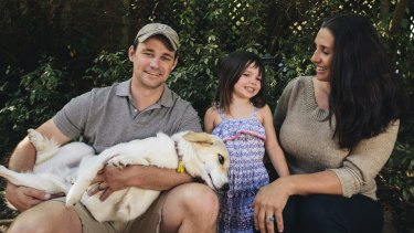 Former United States Marine Eric Yarger with his wife Olympia and their daughter Charlotte, 4, at home in Isaacs with Snickle Fritz, the dog he rescued from a rubbish dump in Afghanistan.