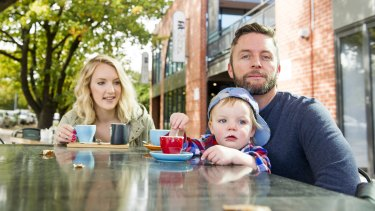 Damien Maher with his wife, Emma, and son, Harry, in Braddon.