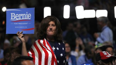 Opposing groups can be urged on through propaganda and misinformation to become more militant. A delegate shows support for Senator Bernie Sanders.