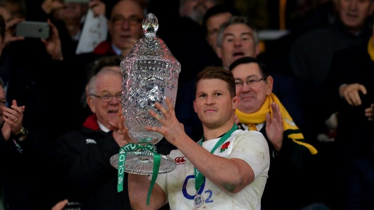 Dylan Hartley of England lifts the trophy after the final whistle.