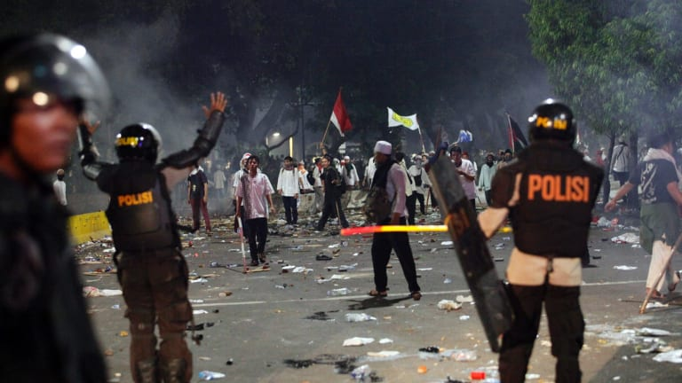 Police during the rally against Ahok in Jakarta.