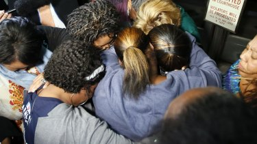 Supporters of the victims pray after the verdicts.