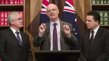 From left, Andrew Wilkie, Reverend Tim Costello of the Alliance for Gambling Reform, and Senator Nick Xenophon.