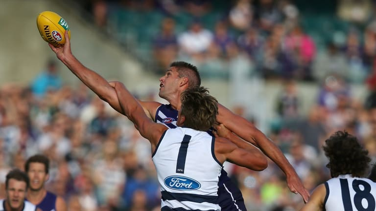 Aaron Sandilands wins one of his 48 hit outs for the Dockers, who also dominated clearances yet were thrashed by Geelong.