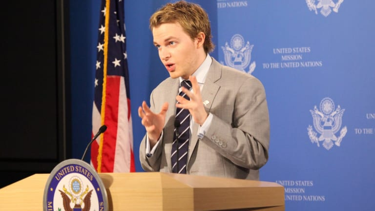 Farrow briefs the press as part of a US mission to the United Nations.