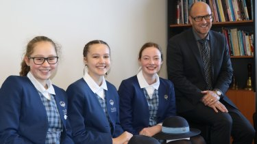 IB students, from left, Alexandra Doubleday, Kate Addison and Sophia Kennaugh with Tara's head of Senior School Scott Baker.