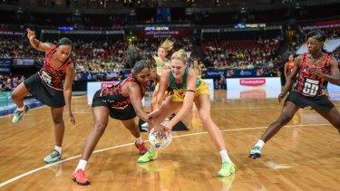 Australia's Caitlin Bassett wears a black armband during Friday night's match against Trinidad & Tobago.