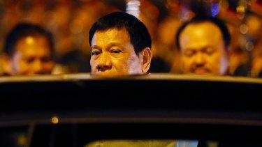 Philippine President Rodrigo Duterte boards his limousine upon arrival in Vientiane, Laos.