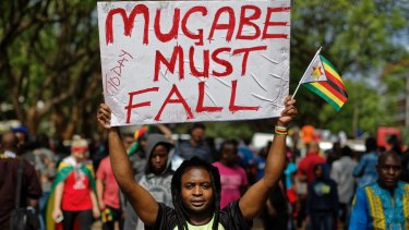 In a euphoric gathering that just days ago would have drawn a police crackdown, crowds marched through Zimbabwe's capital on Saturday to demand the departure of President Robert Mugabe, one of Africa's last remaining liberation leaders, after nearly four decades in power. (AP Photo/Ben Curtis)