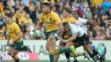 Israel Folau breaks free to score his second try of the afternoon.