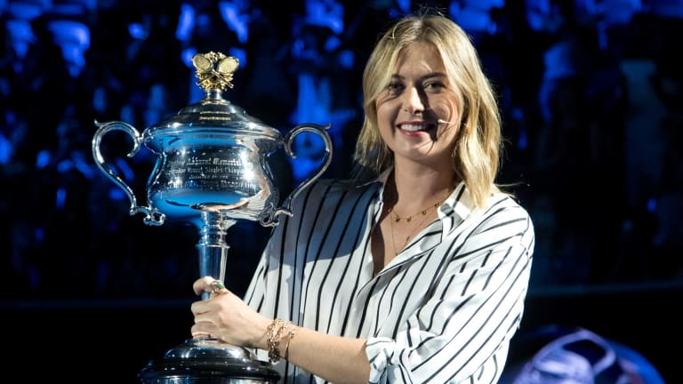 Former ladies single's champion Russia's Maria Sharapova with the Daphne Akhurst Memorial Cup.