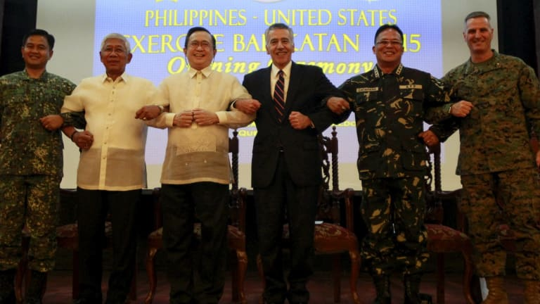 Officials link arms as a show of unity as Philippine and US soldiers began their biggest combined military exercise in 15 years on Monday.