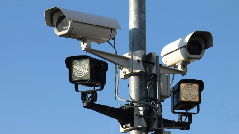 A covertly placed data-linked surveillance camera is much less obvious than a human and is more reliably attentive.