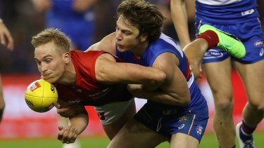 Free choice: Melbourne's Bernie Vince is dispossessed by Liam Picken.