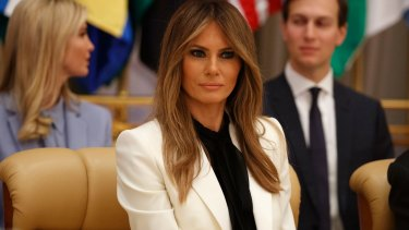 First Lady Melania Trump listens as her husband speaks.