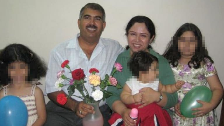 Baha'i man Hamed bin Haydara - here with his family - has been sentenced to death by a Yemeni court on charges of spying for Israel and converting Muslims to the Baha'i faith.