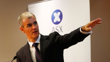 ASX chief executive Elmer Funke Kupper says blockchain will reduce post-trading costs.