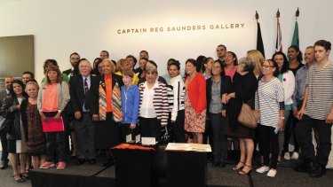 Relatives of Reg Saunders inside the Captain Reg Saunders Gallery.