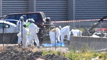 Investigators at the site of the Essendon plane crash.